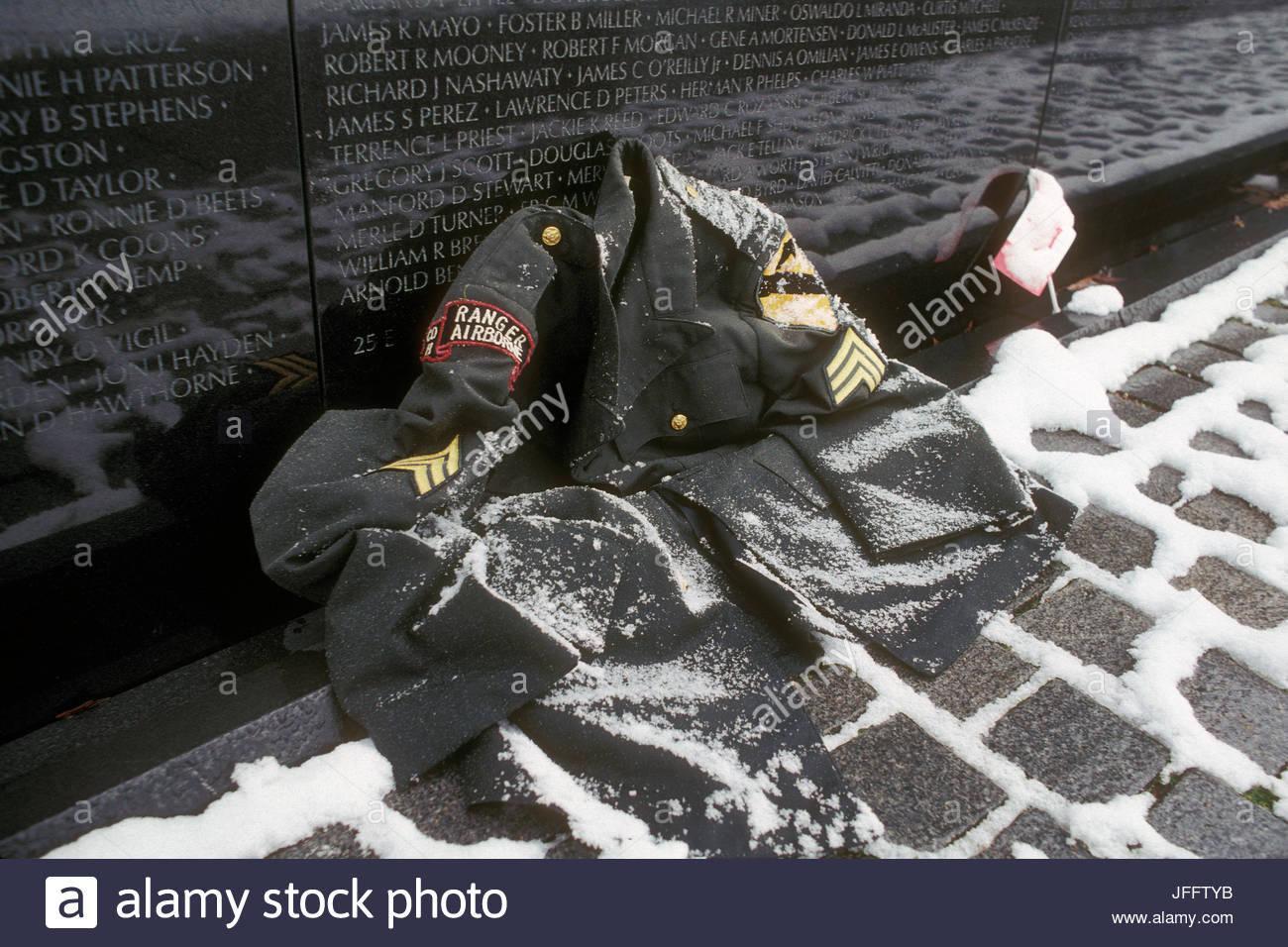 Part of a Vietnam era Army dress uniform in the snow at the Vietnam Veterans Memorial. - Stock Image