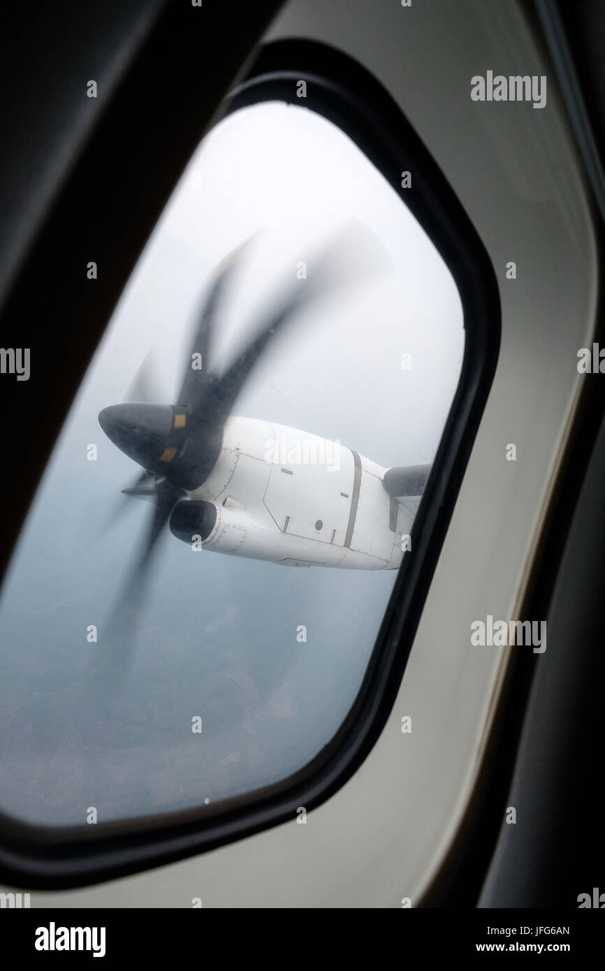 Window view of an engine propeller airplane viewed from inside the aircraft - Stock Image