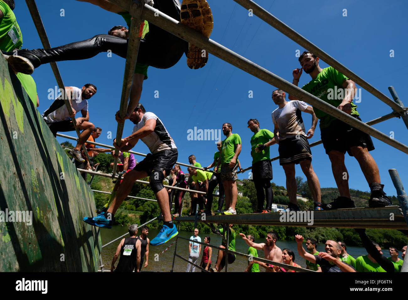 Athletes participating on an obstacle course race - Stock Image
