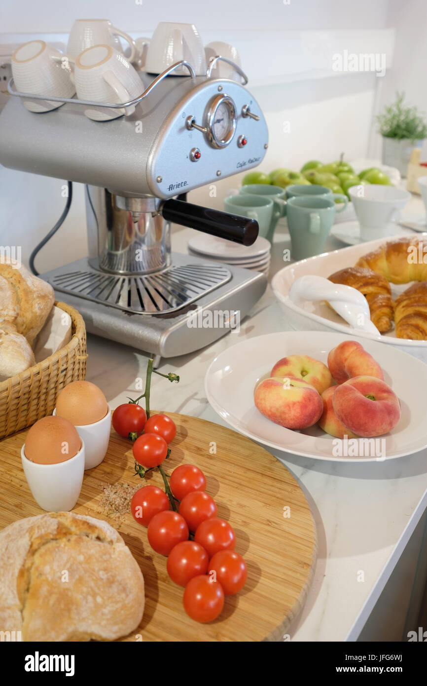 Breakfast table with coffee maker - Stock Image