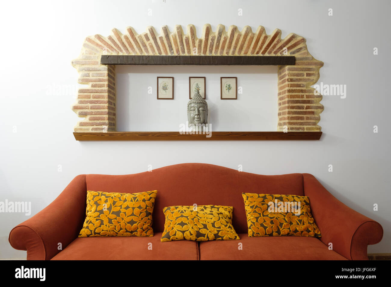 Sofa with three yellow pillows - Stock Image