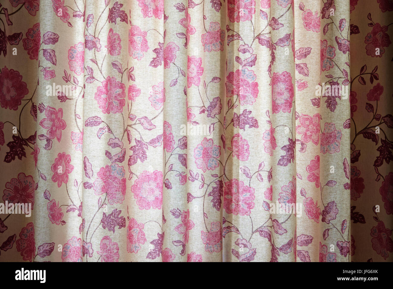 Curtains with pink floral pattern - Stock Image