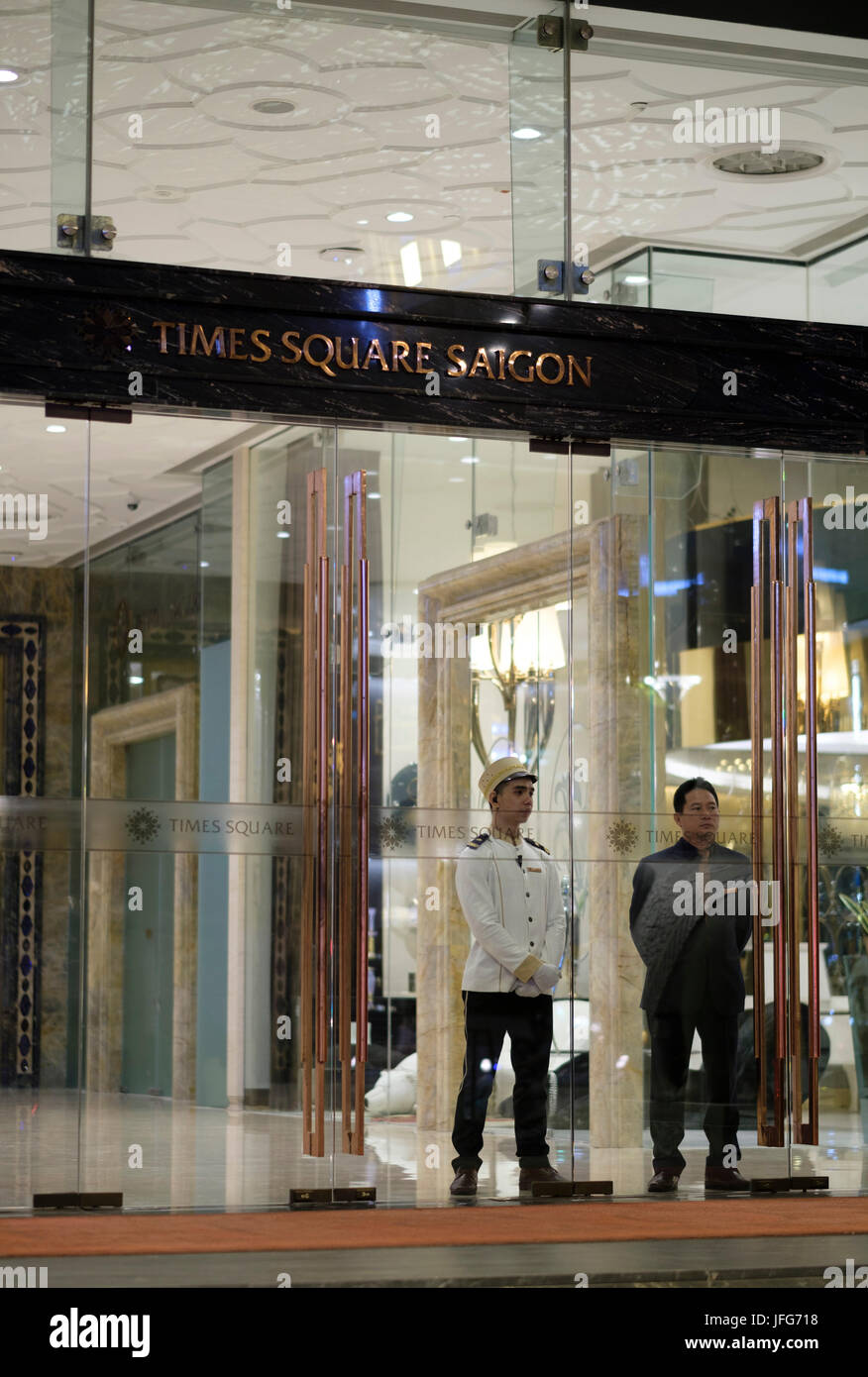 Bellboy in uniform inside the Times Square Saigon hotel in Ho Chi Minh City, Vietnam, Asia - Stock Image