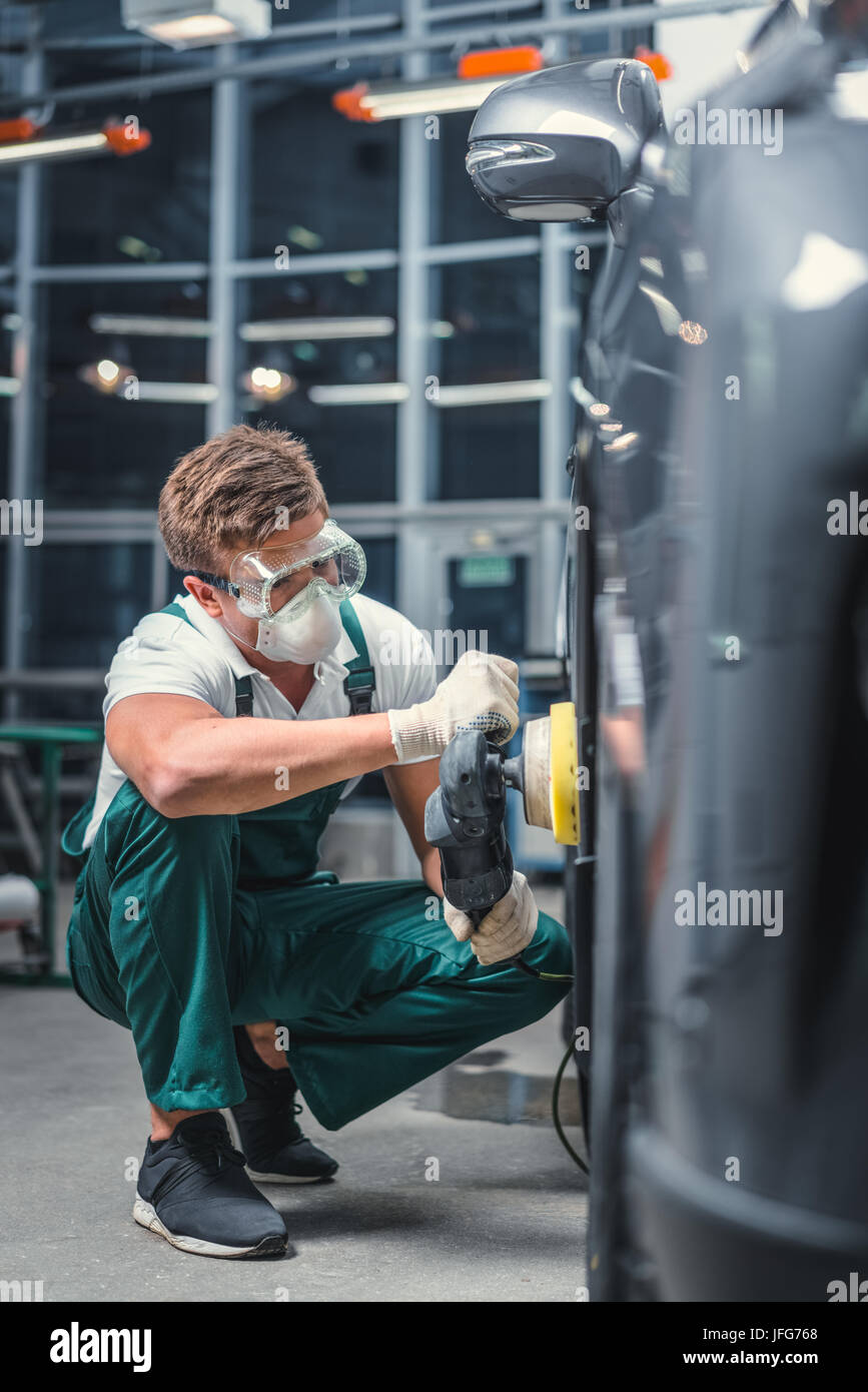 Mechanic in uniform - Stock Image