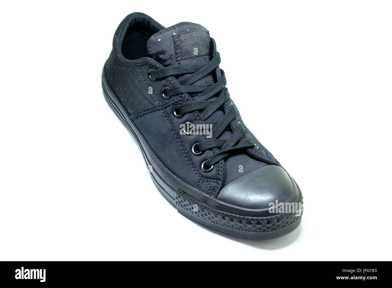 Black Converse Chuck Taylor All Star shoe - Stock Image