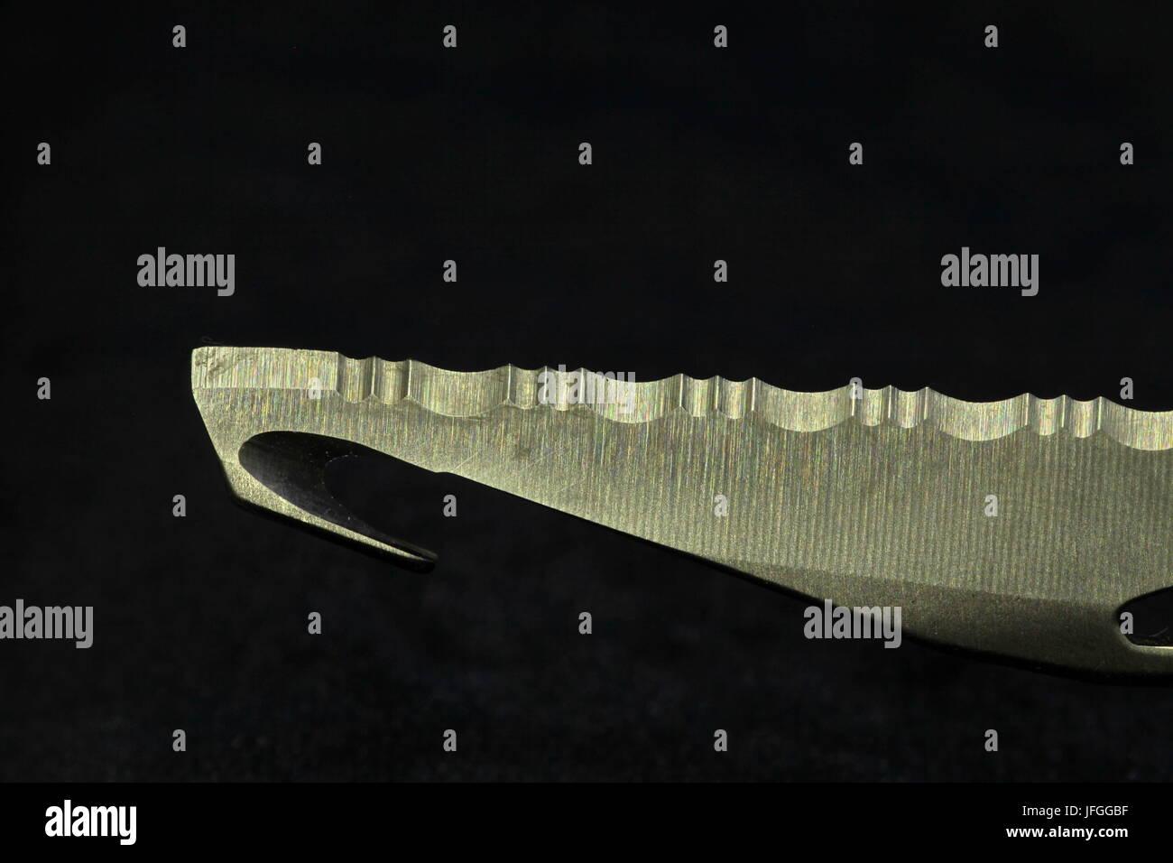 Steel knife Wavy blade - Stock Image