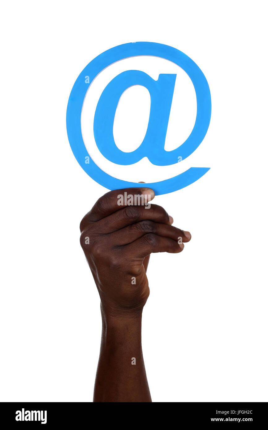 Hand halten @ at Zeichen von Computer E-Mail - Stock Image