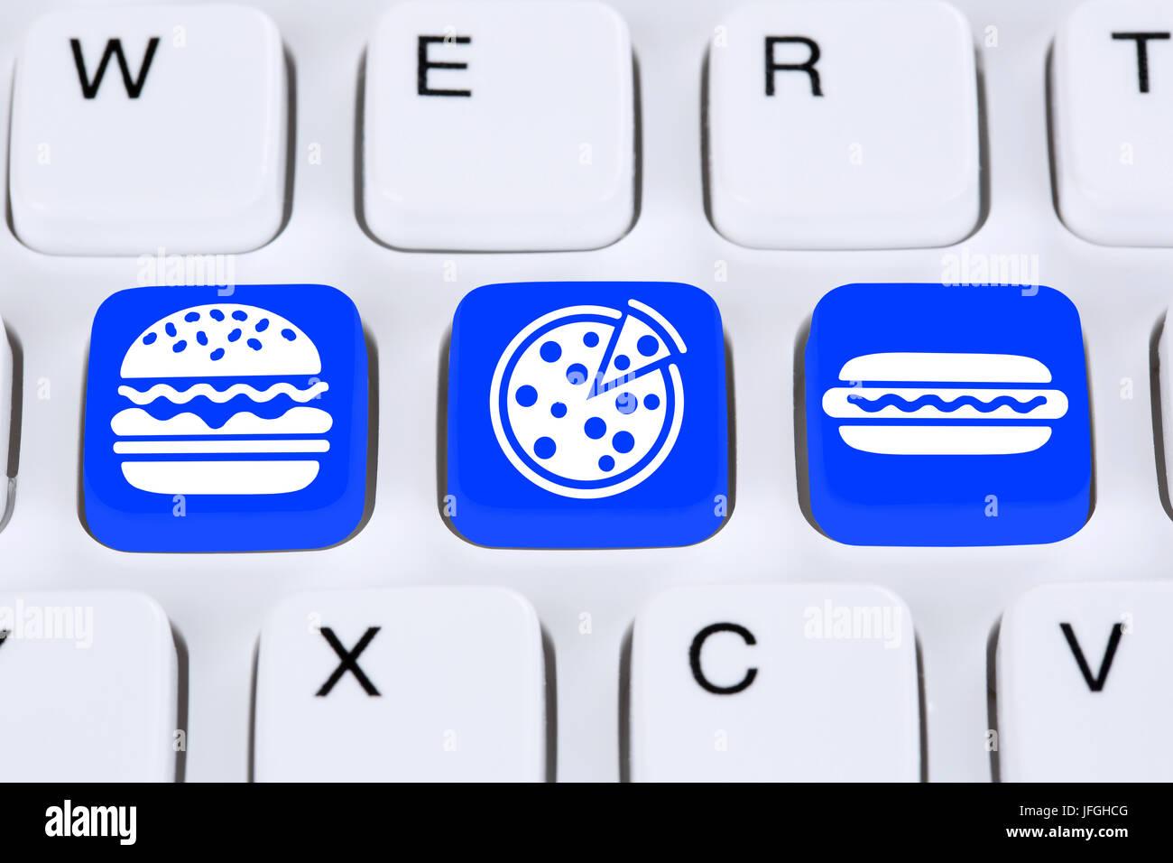 Pizza Hamburger Fast Food essen online bestellen und liefern im Internet Computer Stock Photo