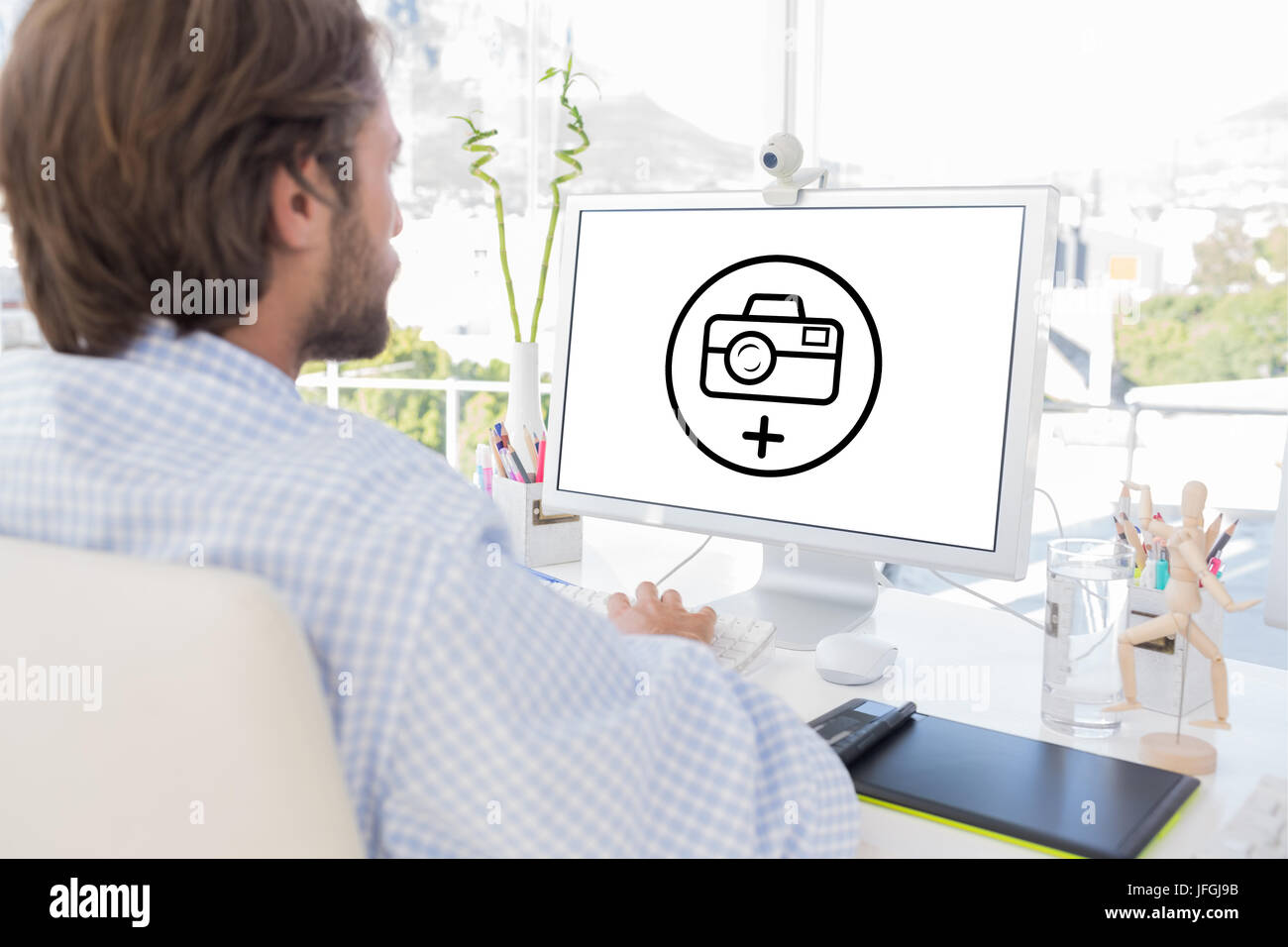 Composite image of desinger working on his computer - Stock Image
