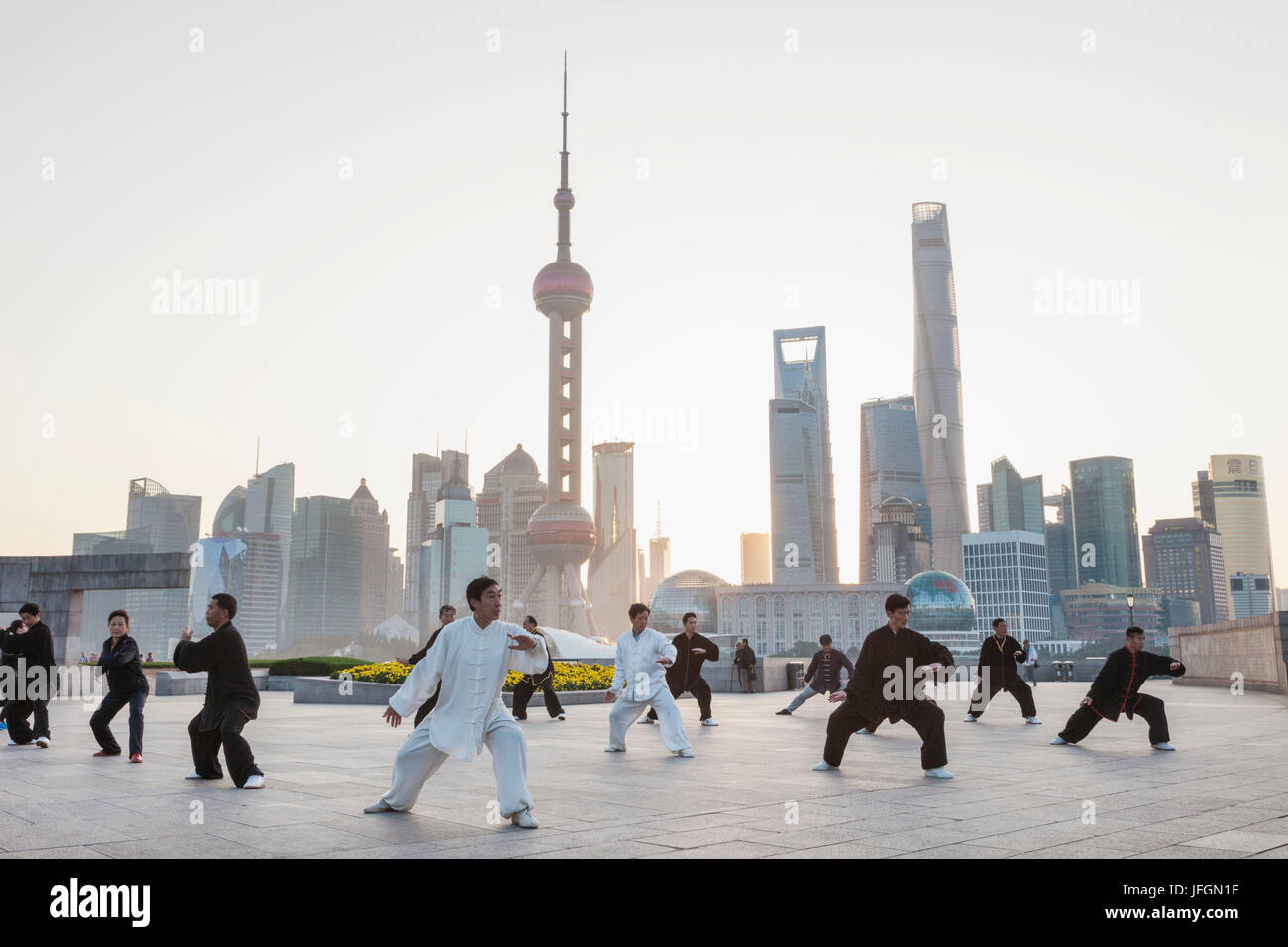 China, Shanghai, The Bund, Group Practicing Tai chi - Stock Image