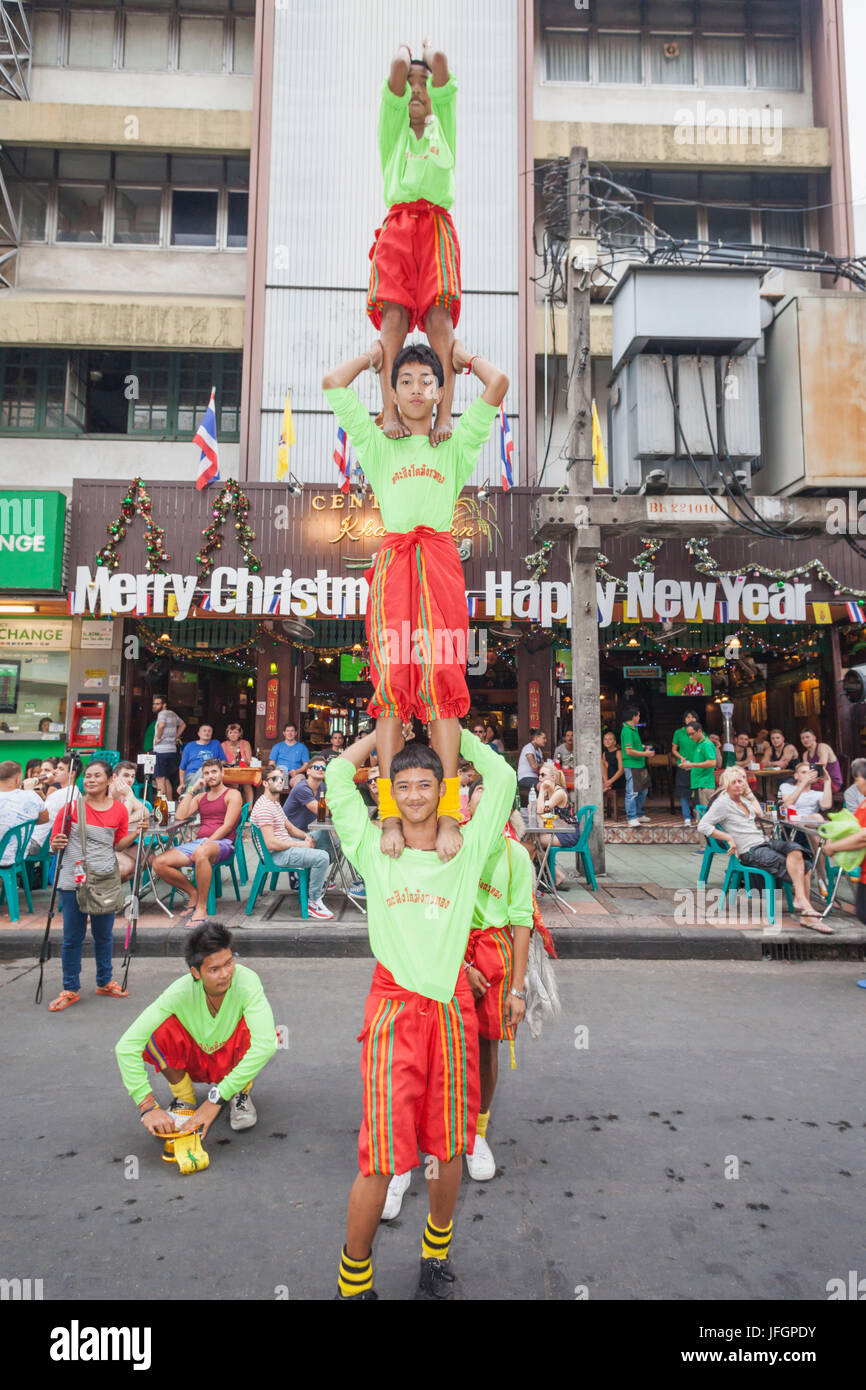 Thailand, Bangkok, Khaosan Road, Street Performance of Acrobatic Troupe - Stock Image