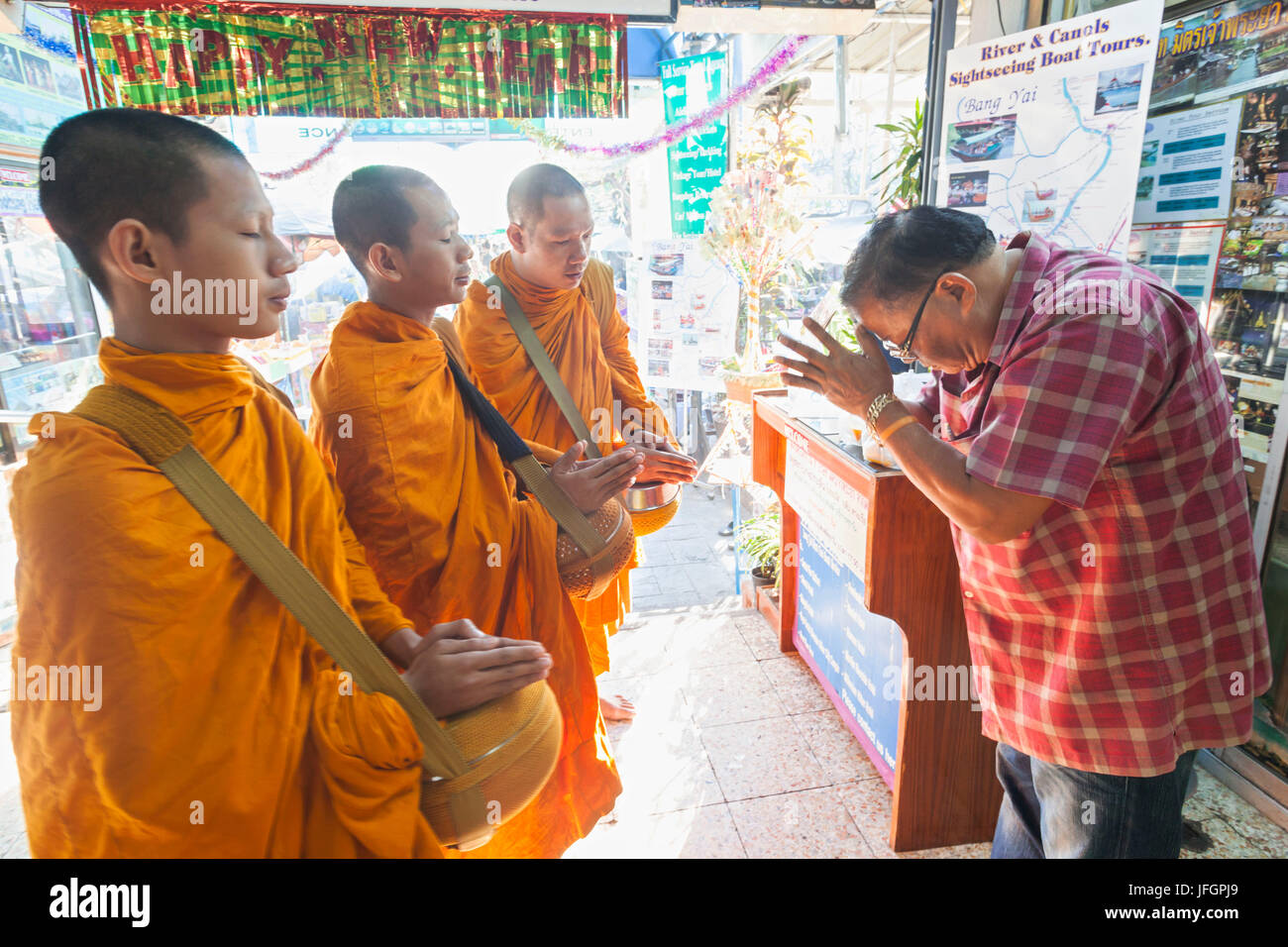 Thailand, Bangkok, Man Praying to Monk - Stock Image