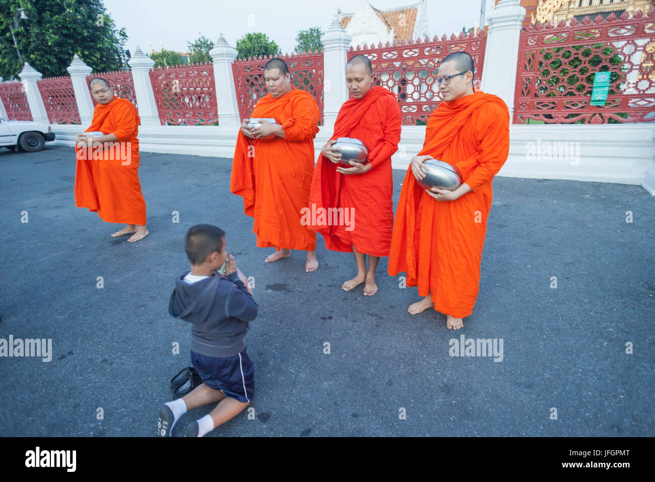 Thailand, Bangkok, Wat Benchamabophit aka The Marble Temple, Child Praying to Monks Stock Photo