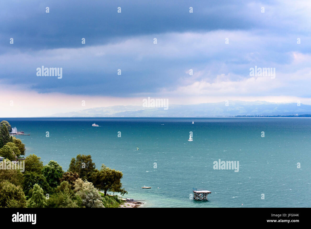 View at Lake of Constance, dark clouds, Überlinger lake with Meersburg, Baden-Wurttemberg, Germany - Stock Image