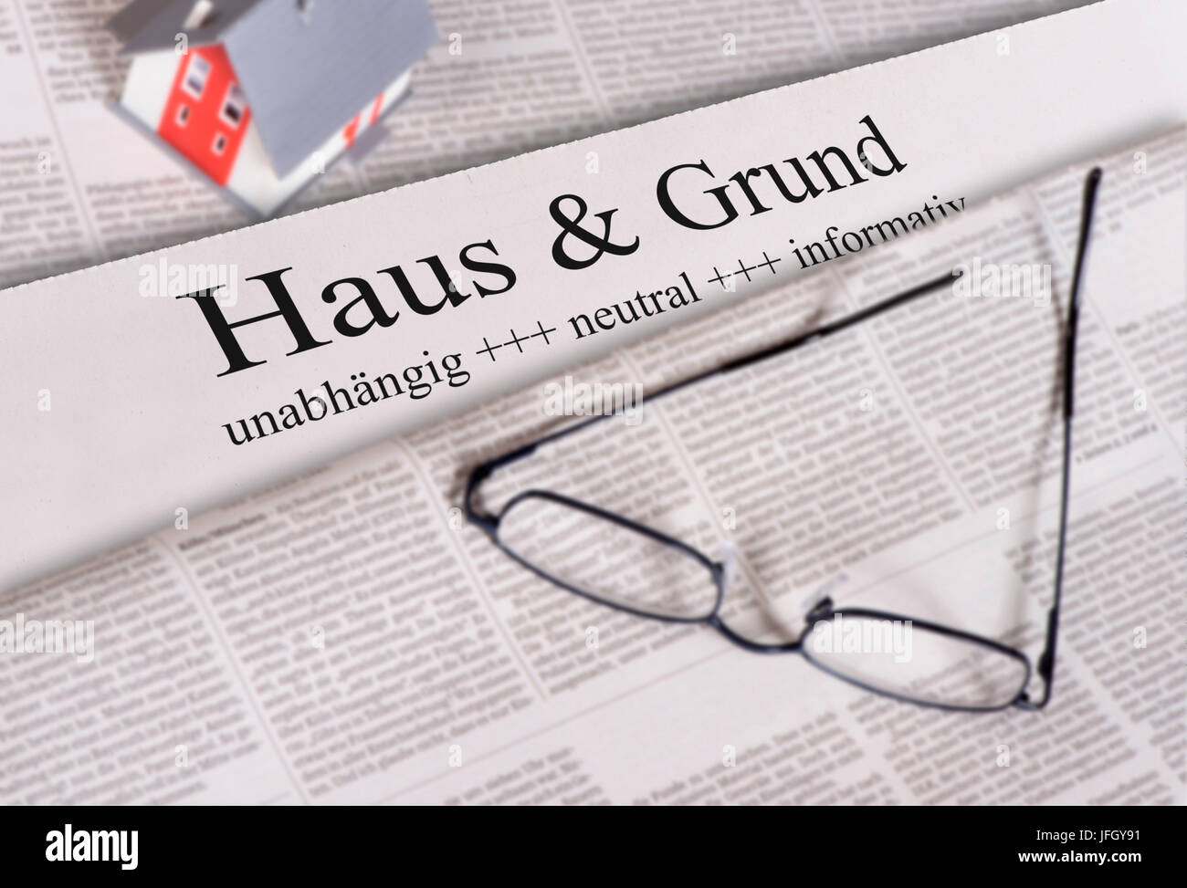 Newspaper with heading house & ground - Stock Image
