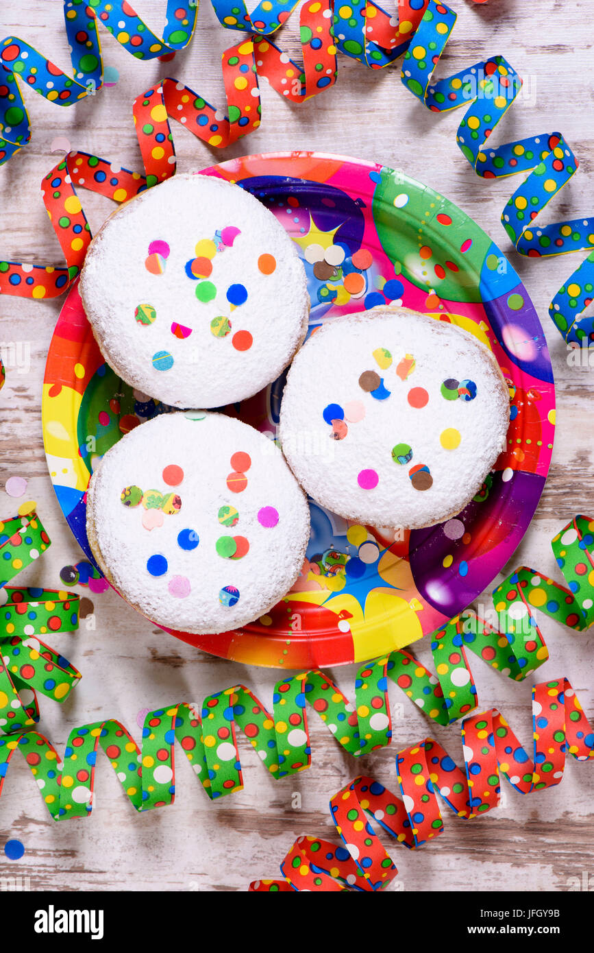 Carnival doughnuts to carnival with streamers - Stock Image