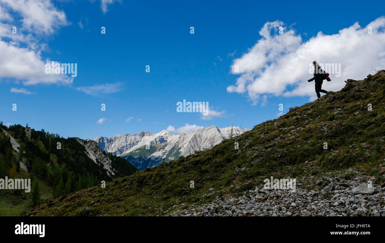Traveller as a silhouette in the big Gschnierkar, view about Hinterautal on Hinterau Vomper mountain range with - Stock Image