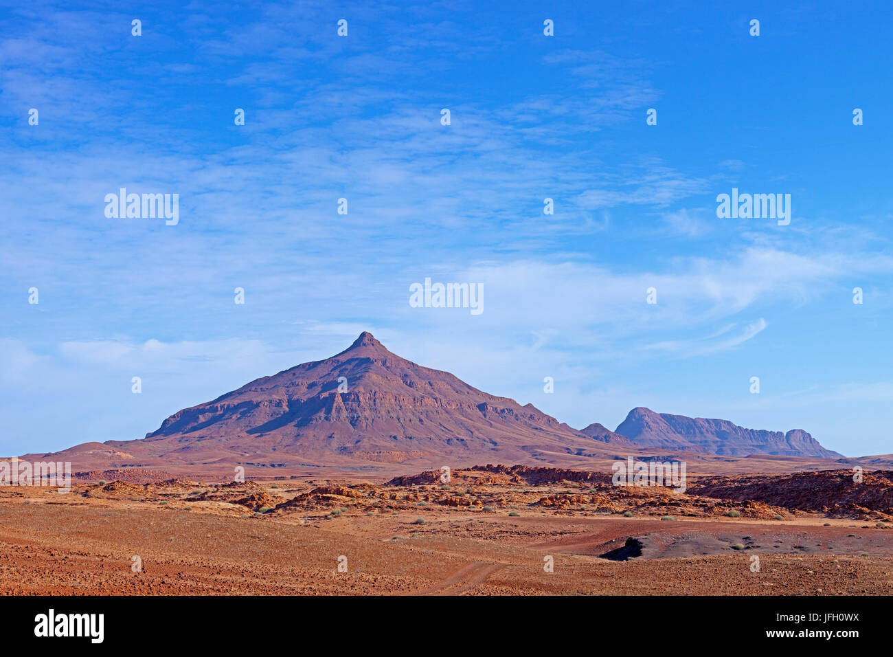 Mountain landscape with pointed rock cone, sandstone abnormal termination, erosion, Damaraland, Namibia - Stock Image
