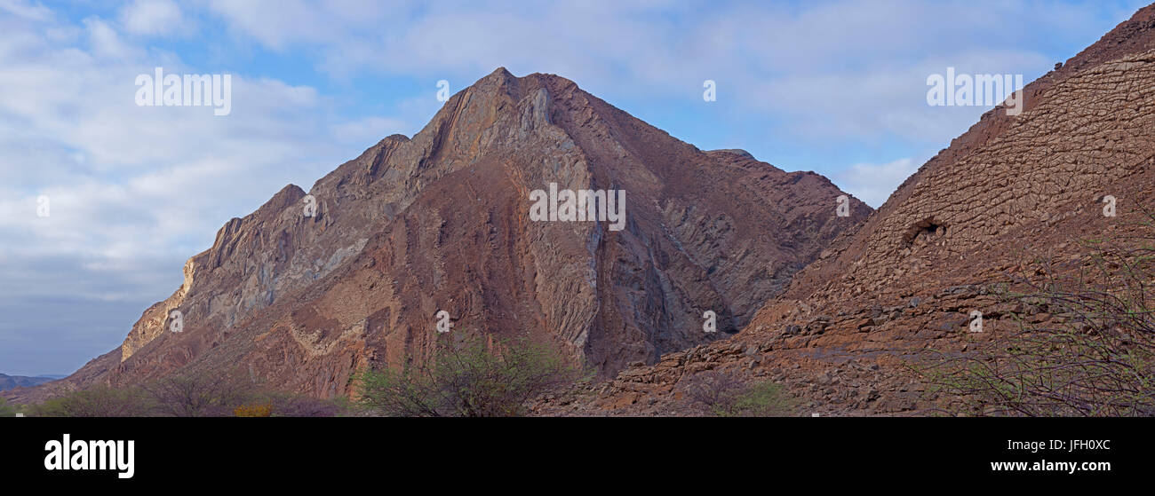 Cliff faces with wave-shaped rejections and quaderartiger resolution, Damaraland, Namibia, panorama - Stock Image
