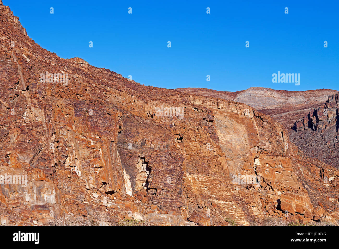 eroded, coloured cliff face with rejections, Damaraland, Namibia - Stock Image