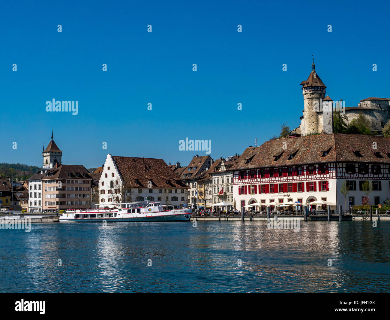 View over the Rhine on the promenade with the restaurant good court and the fortress attachment Munot, Old Town, - Stock Image