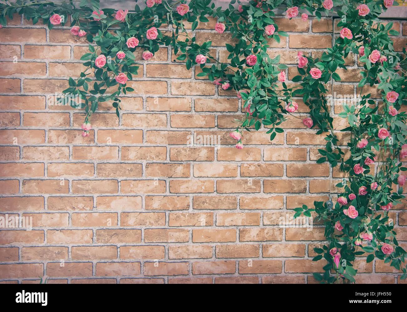 Bush Climbing Rose On A Brick Wall Background Artificial