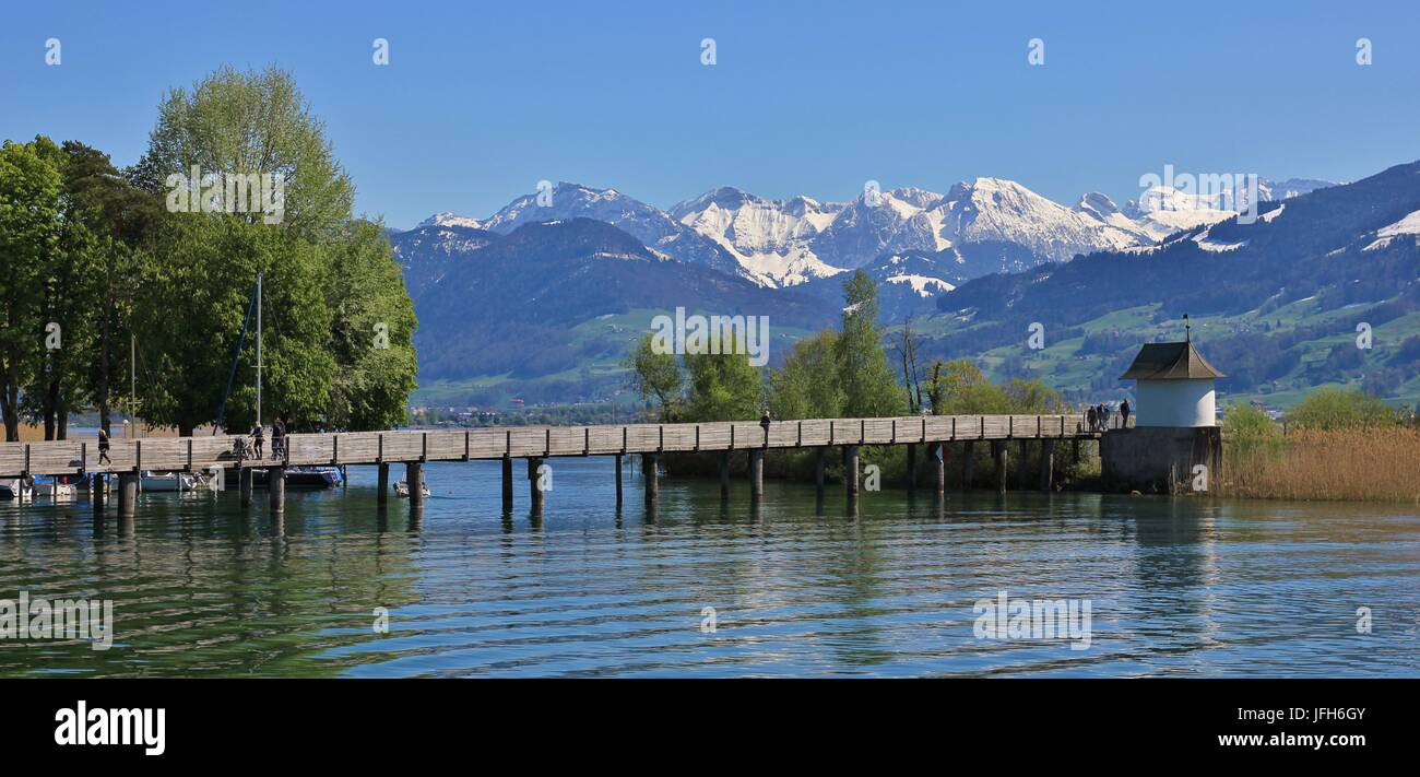 Lake Zurichsee and snow capped mountains Stock Photo