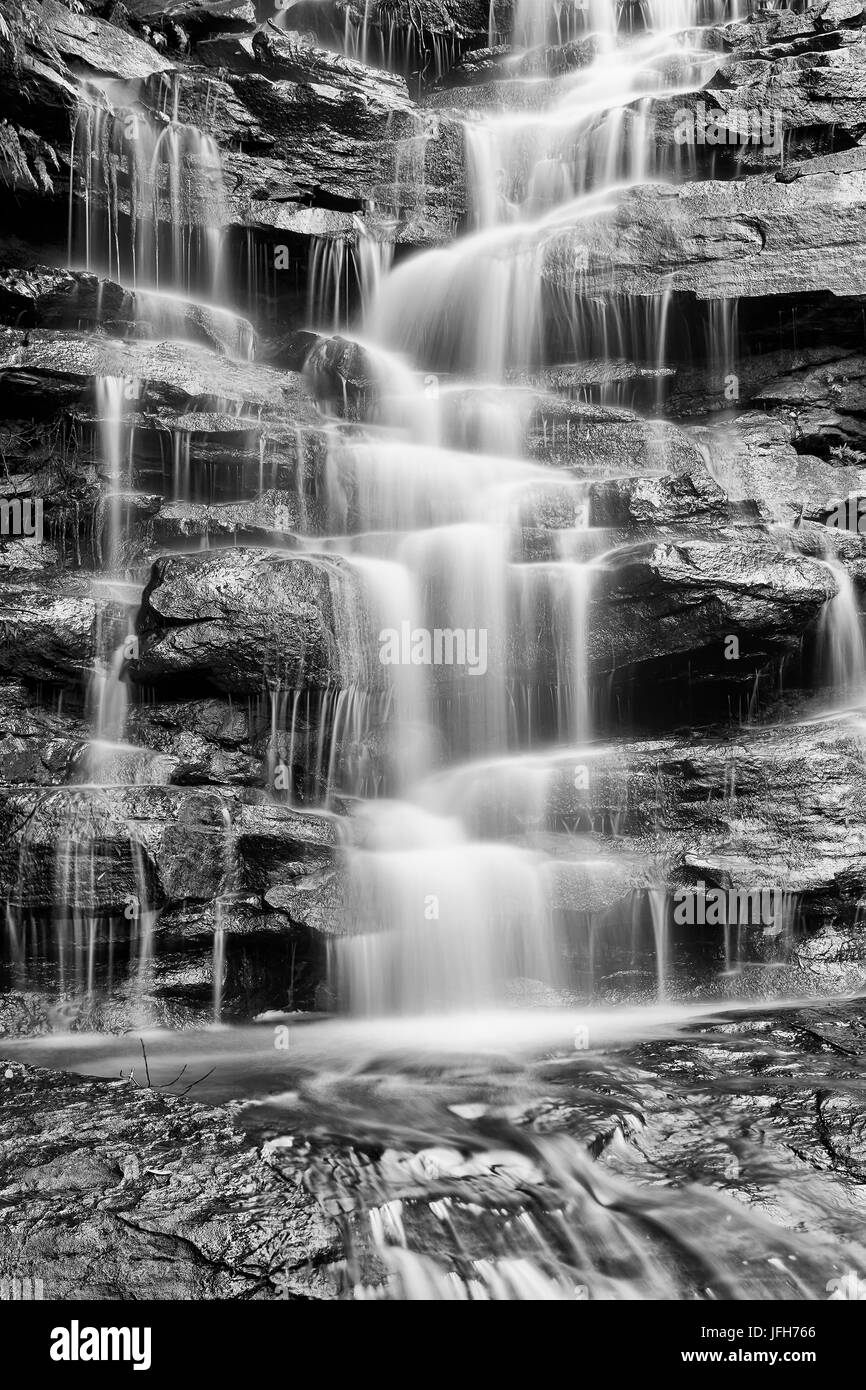 Fragment of vertical waterfall on sandstone cascade in rain-forest creek on Australian central coast converted by - Stock Image