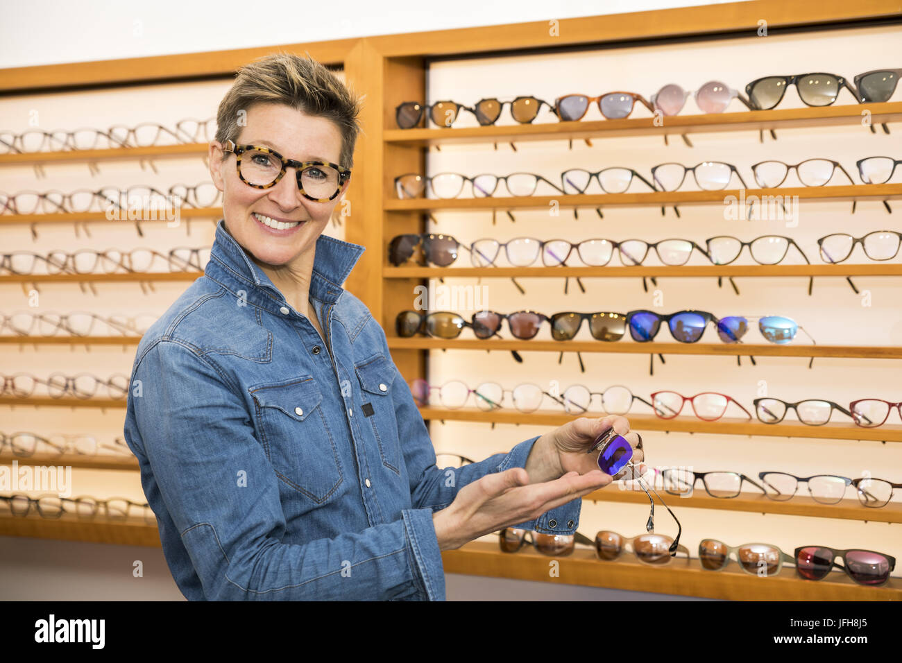 woman in a eyewear store - Stock Image