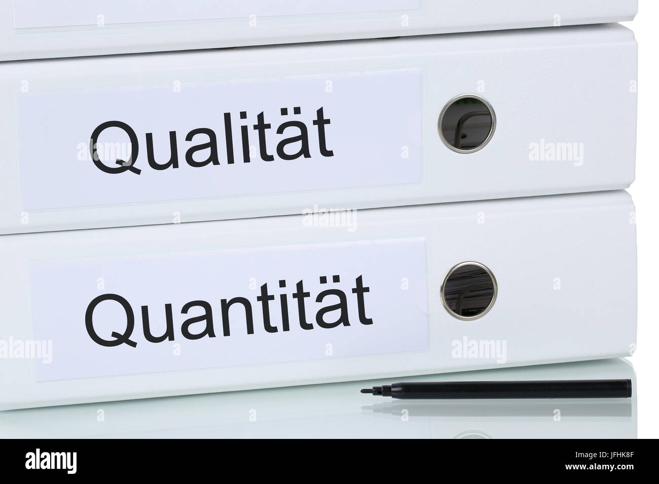 Mit Qualität und Quantität zum Erfolg Business Konzept Stock Photo