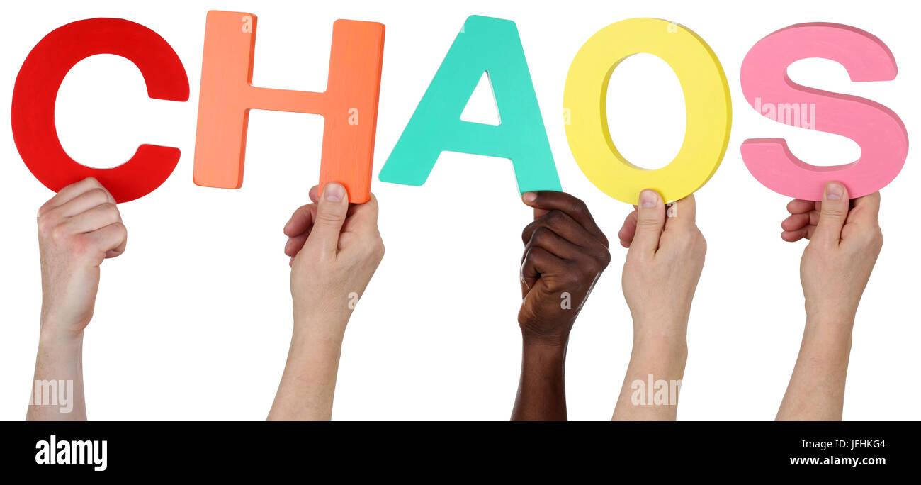 Multikulturell People Gruppe halten das Wort Chaos - Stock Image
