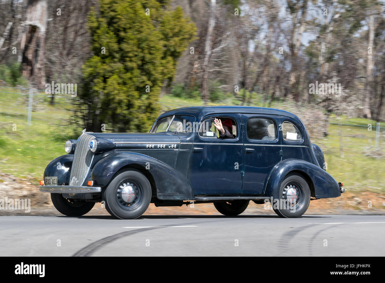 Vintage 1936 Oldsmobile FR Sedan driving on country roads near the town of Birdwood, South Australia. - Stock Image