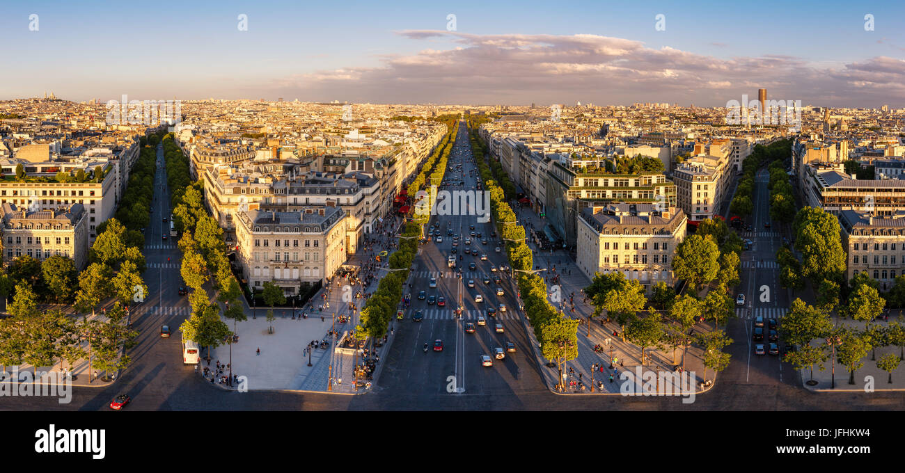 Summer panoramic view on the Champs-Elysees and Paris rooftops at sunset. France Stock Photo