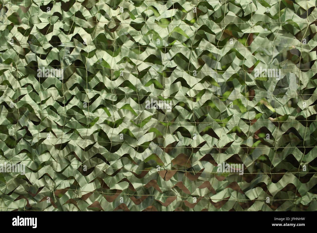 military camouflage net background - Stock Image