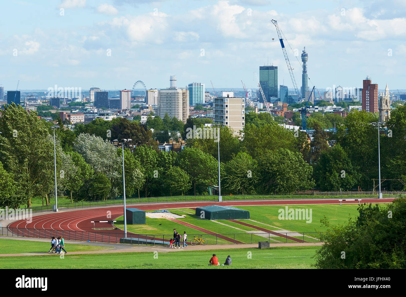 London skyline from Hampstead Heath, with Parliament Hill Fields athletics track in foreground - Stock Image