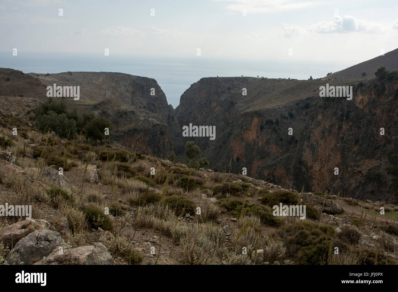 Aradena Gorge is a deep limestone canyon running from the Lefka Ori or White Mountains down to the South coast of Stock Photo