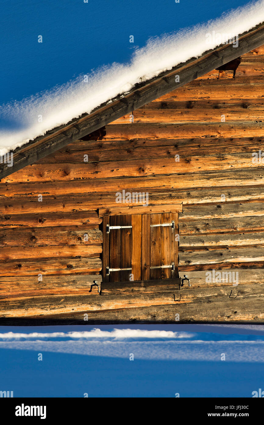 The afternoon sun shines on the houses at the Wiesner Alp in Canton of Grisons - Stock Image