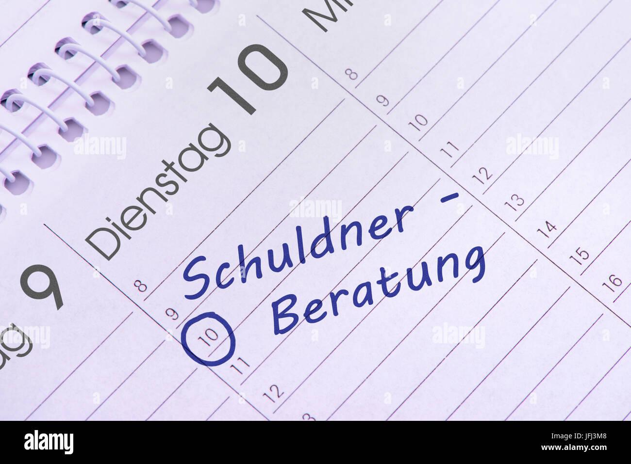 debt advice service date in the calendar - Stock Image