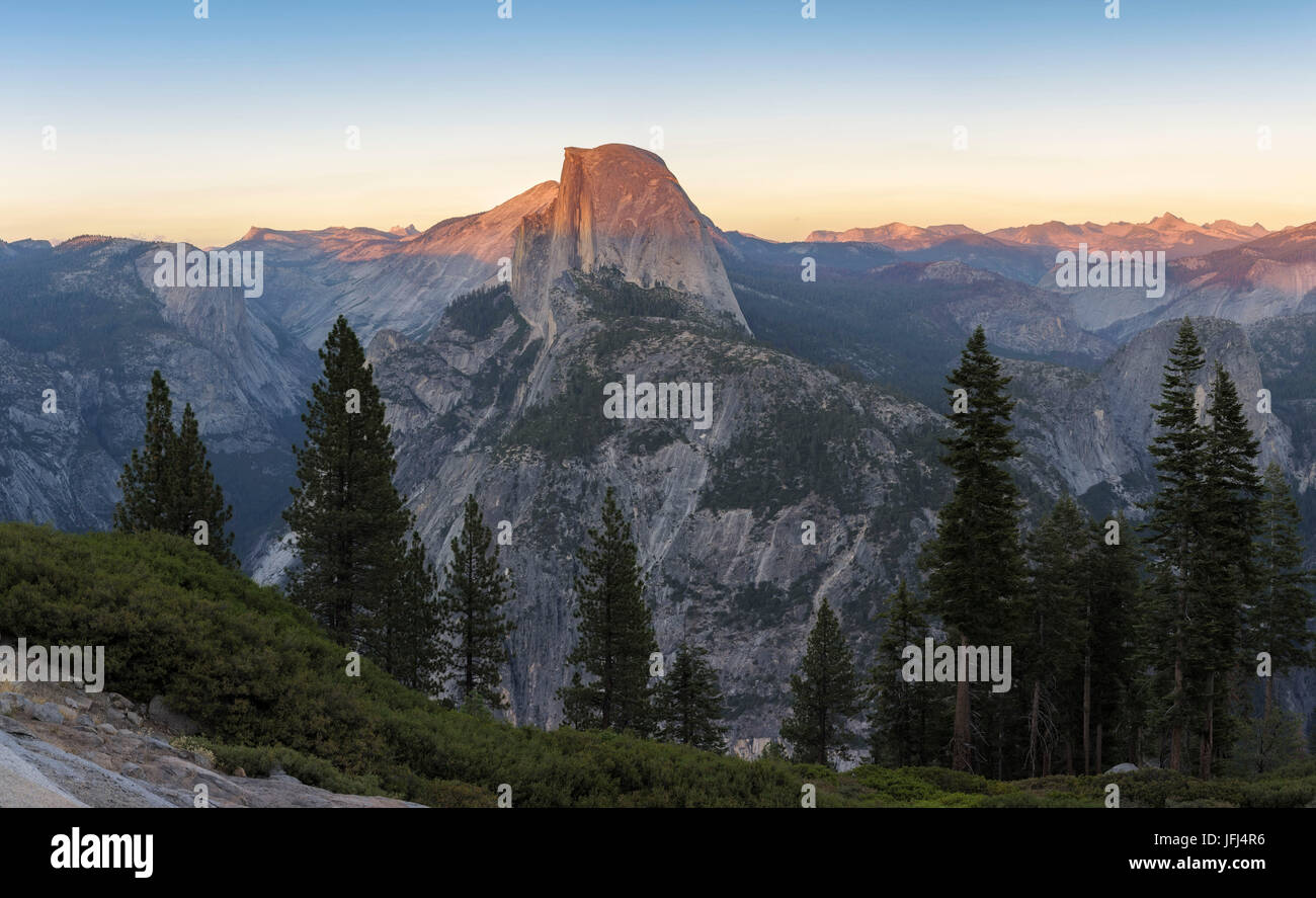 The Half Dome is illuminated perfectly by the setting sun sun, the USA, California, Yosemite national park - Stock Image