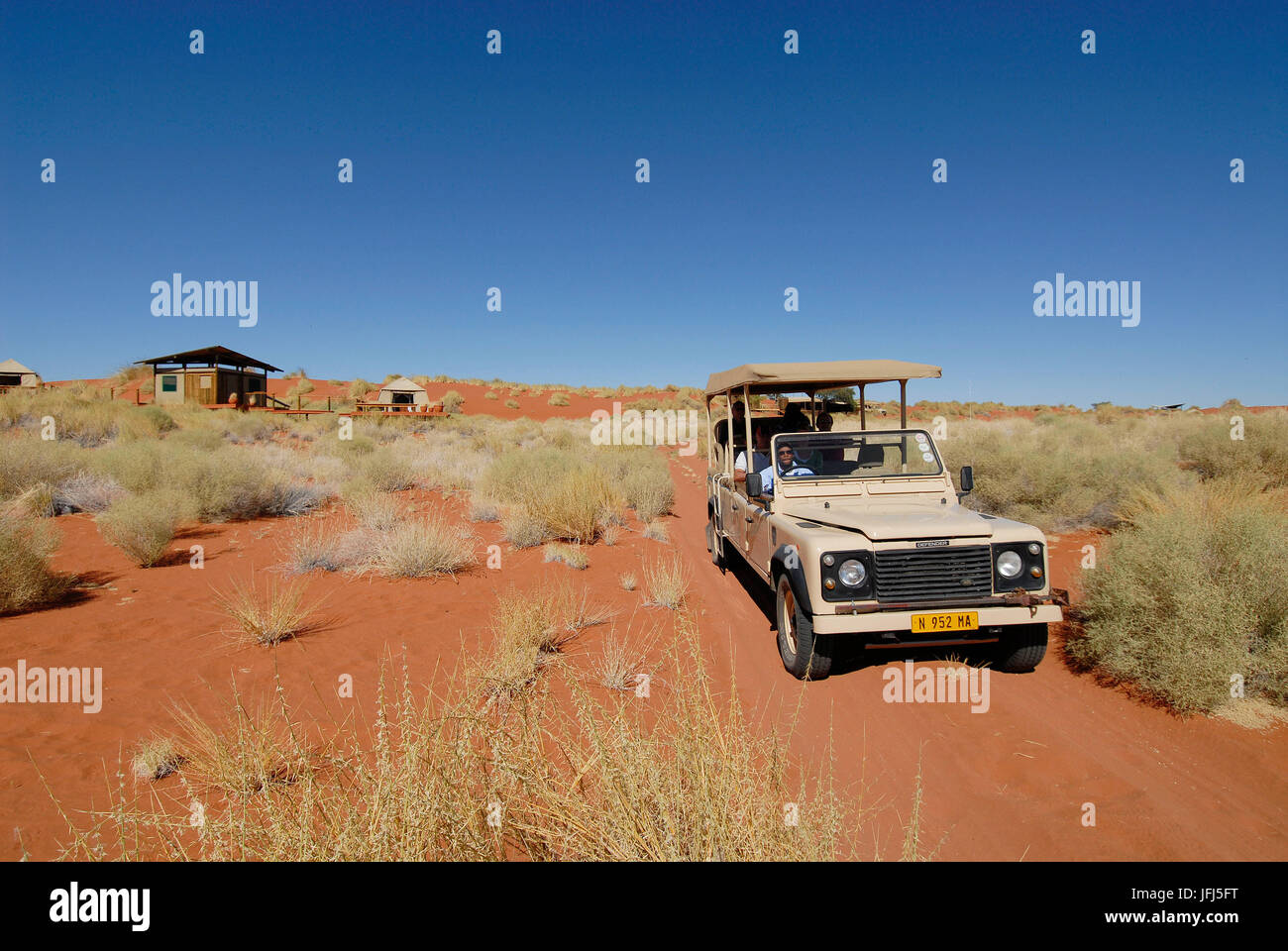Africa, Namibia, NamibRand Nature Reserve, Wolwedane Dunes, camp, safari, sport utility vehicle - Stock Image