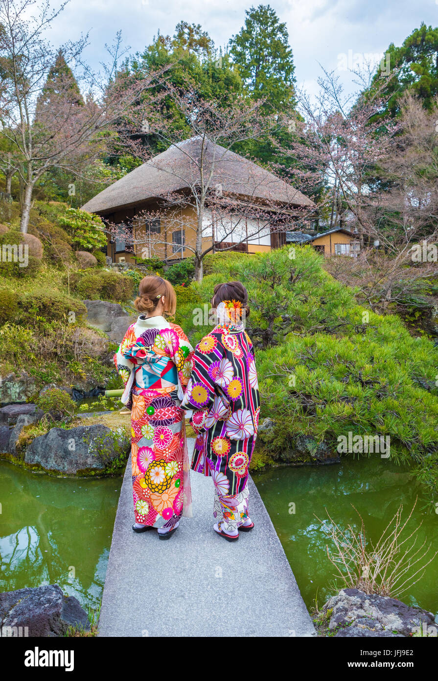 Japan, Kyoto City, girls at garden - Stock Image