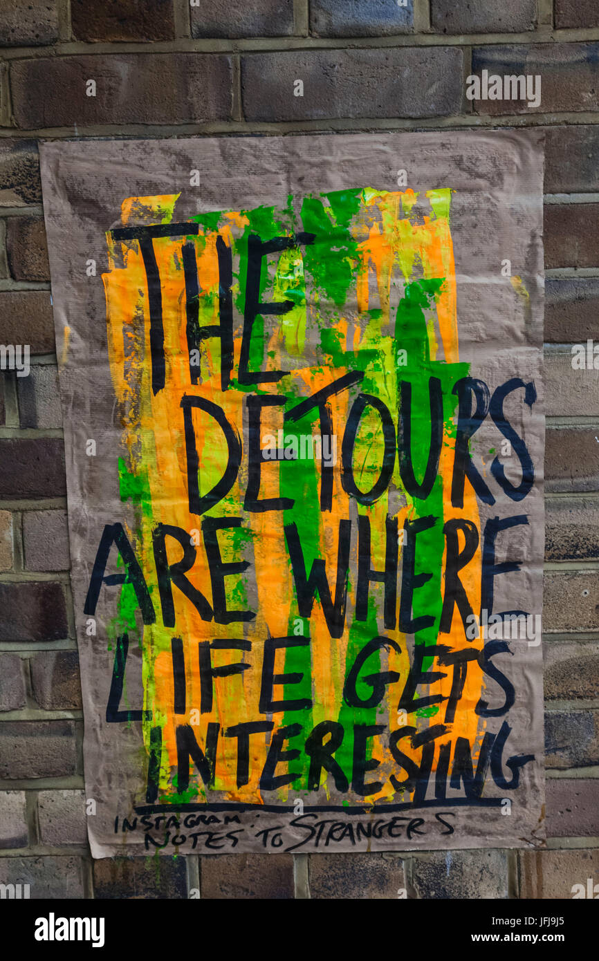 England, London, Lambeth, Wall Poster with Message 'The Detours Are Where Life Gets Interesting' - Stock Image