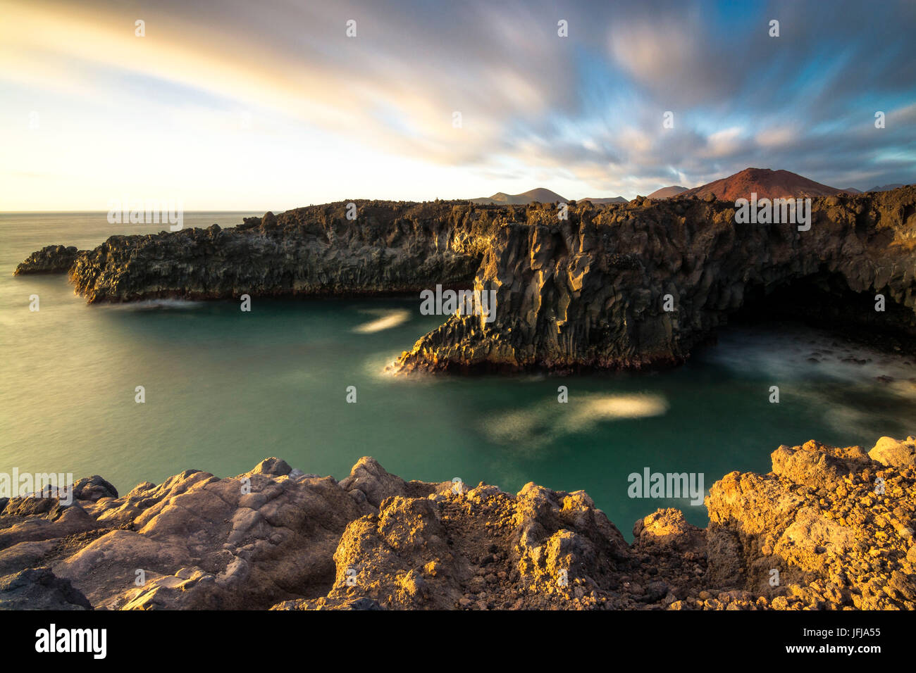 Los Hervideros - Yaiza, Lanzarote Los hervideros is characterized by rocky cliffs overlooking the Atlantic and in Stock Photo