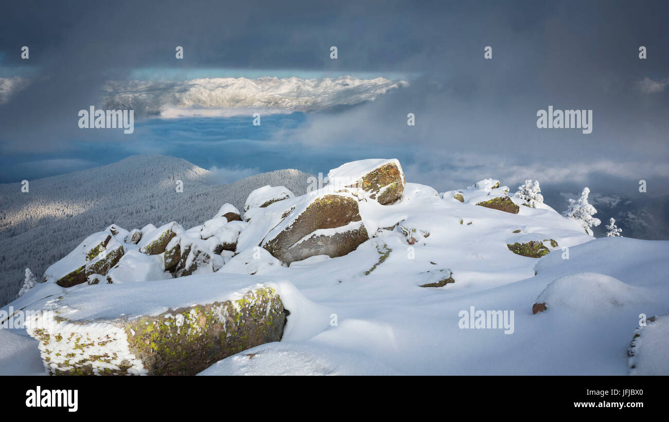 a suggestive landscape from the peak of Rasciesa Mount (Raschötz) in an early morning after a snowfall, Val - Stock Image