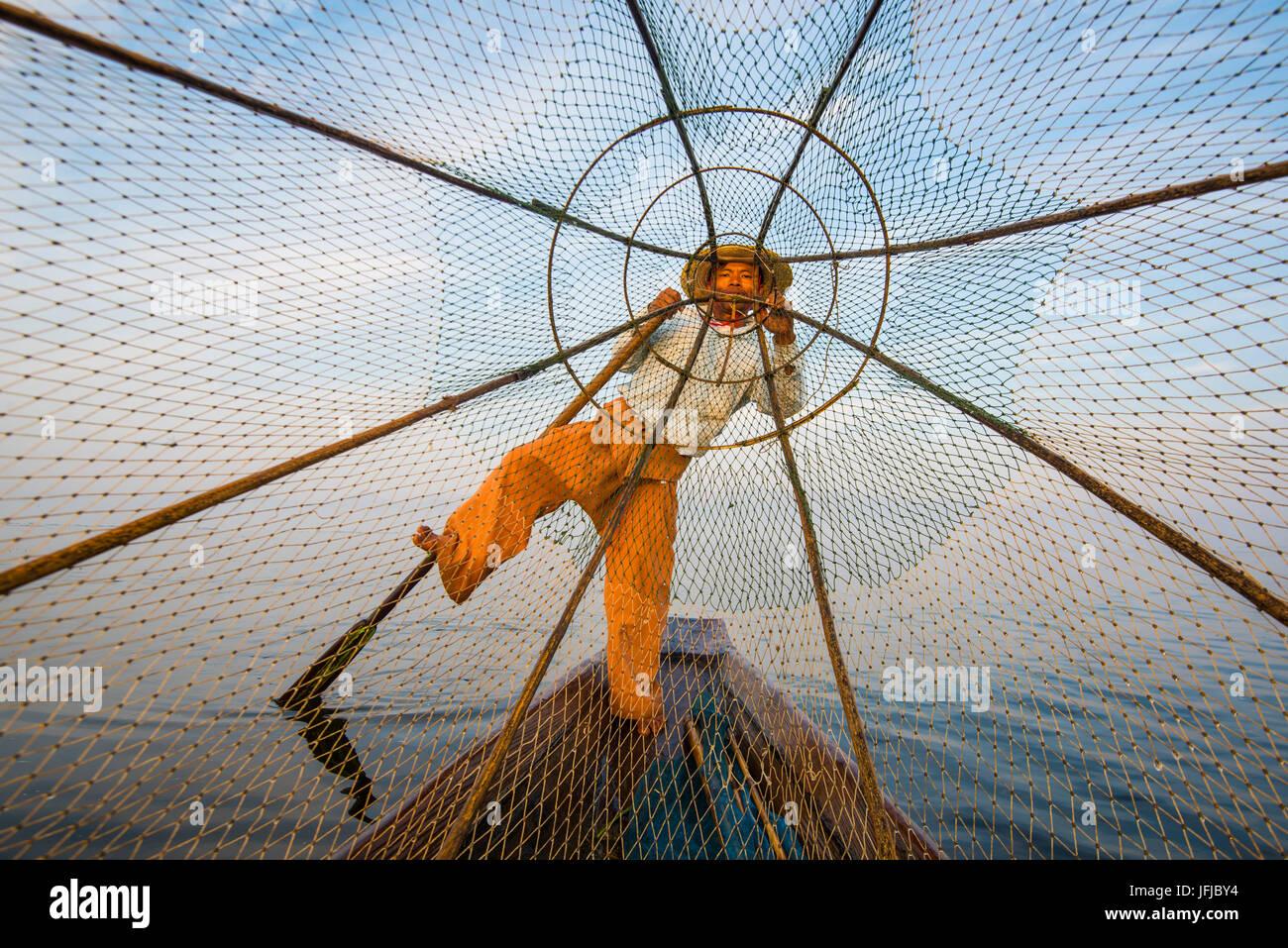 Inle lake, Nyaungshwe, Shan state, Myanmar, Fisherman looking through the fishing net, - Stock Image