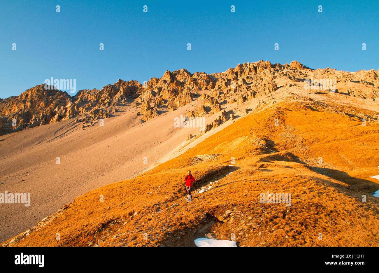 Europe, Italy, Lombardy, Trekking along Ables pass in Valfurva mountains - Stock Image