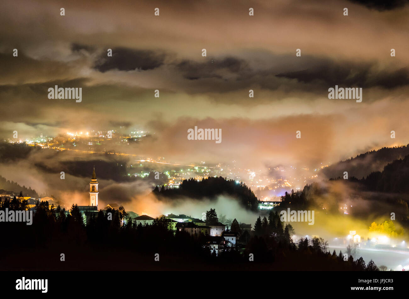 Lorenzago di Cadore, Dolomiti, Veneto, Italy, Lorenzago wrapped in the mist of the night - Stock Image