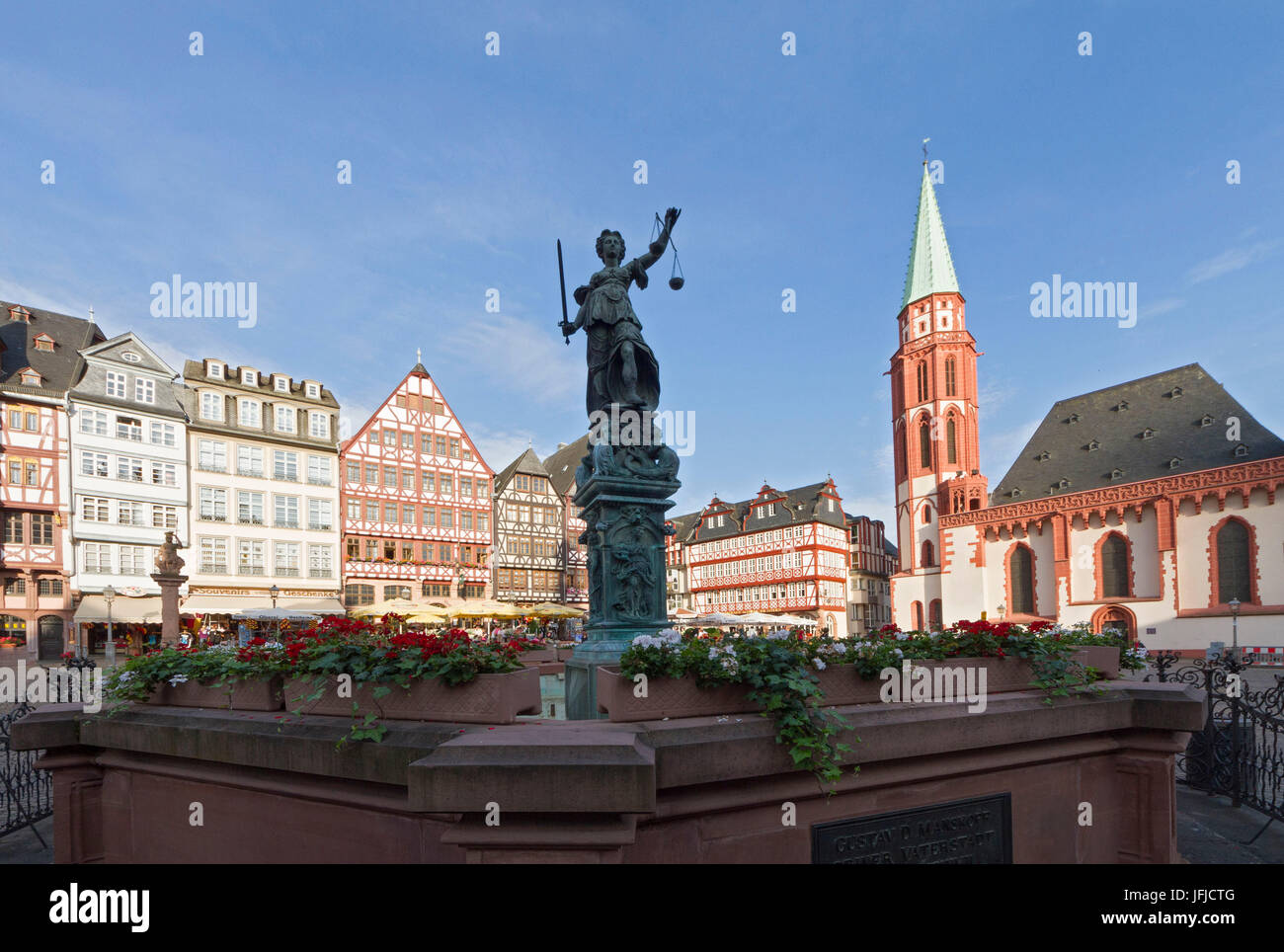 The Romerberg square with Justice statue in the center and the San Nicola Church, Frankfurt, Germany - Stock Image