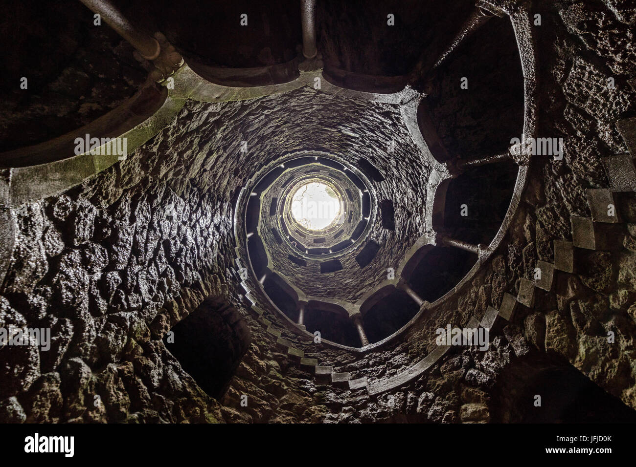 Spiral stairs and mystical atmosphere inside the towers of Initiation Well at Quinta da Regaleira Sintra Portugal - Stock Image