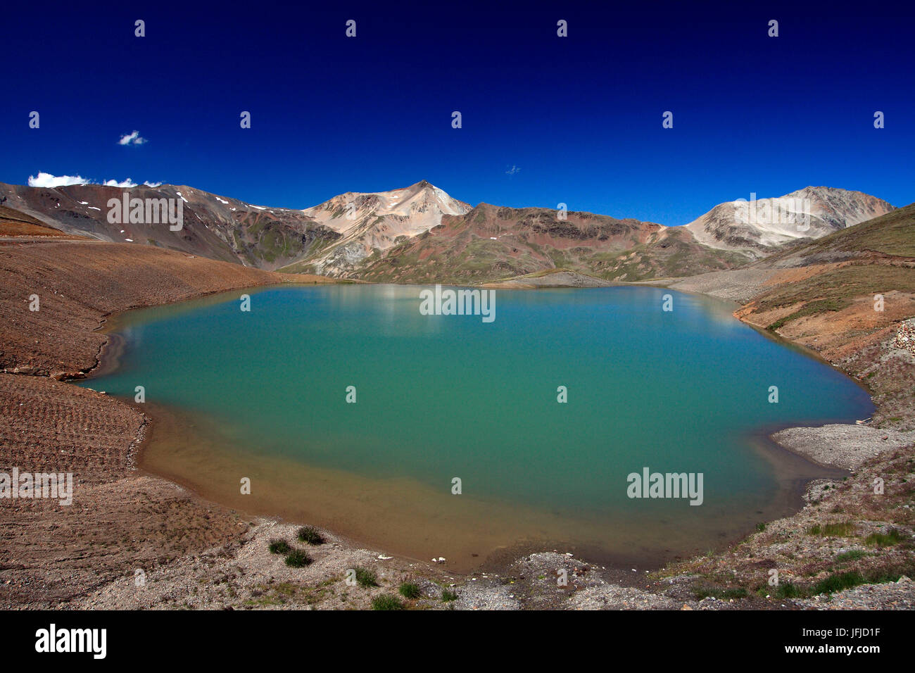 Lake Salin a small body of water on arrival of the ski lifts in Livigno used for artificial snow for the ski slopes - Stock Image